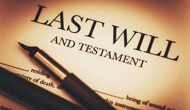 """Last Will and Testament"" paper, with a pen resting on top."
