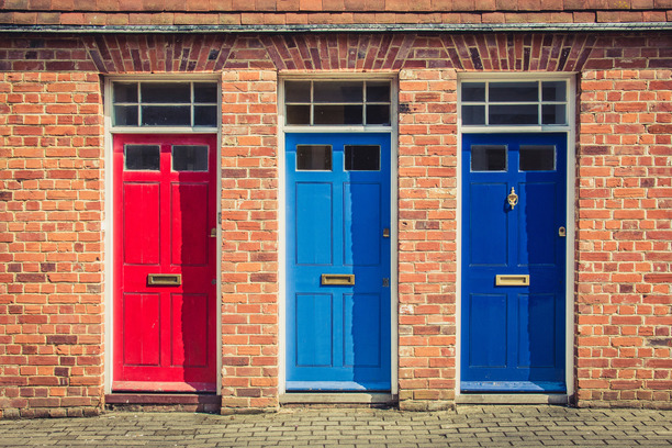 Three property doors, in different colours: red, light blue and dark blue.