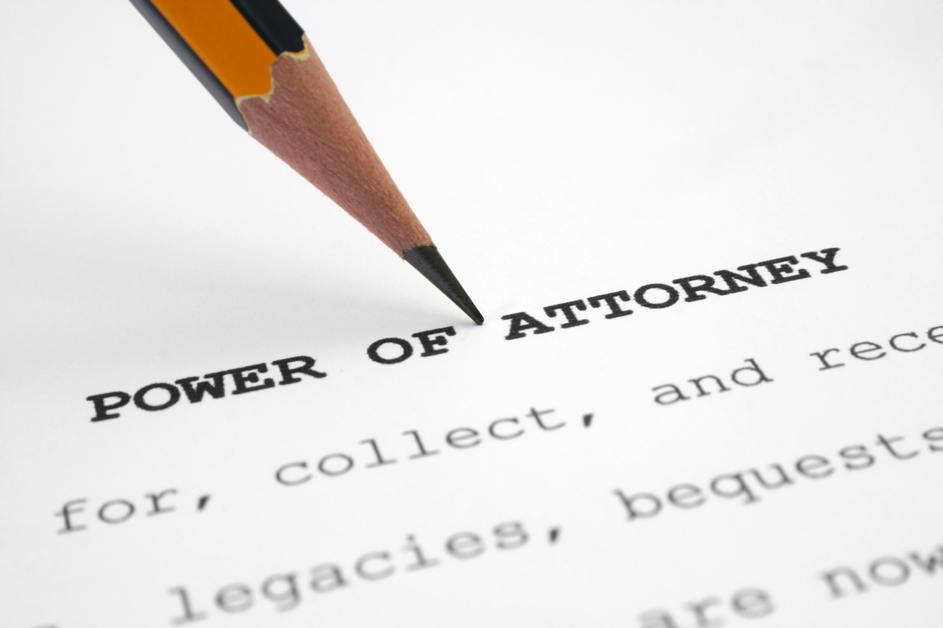 Power of Attorney papers with a pencil marking near the top.