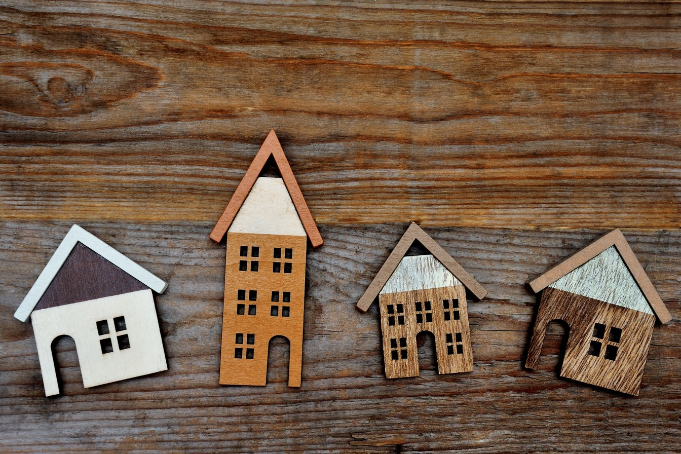 Selection of Wooden Houses on a Wooden Background