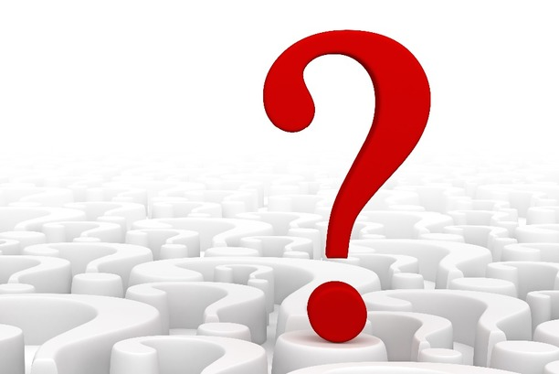 A big red question mark against a white background of question marks.