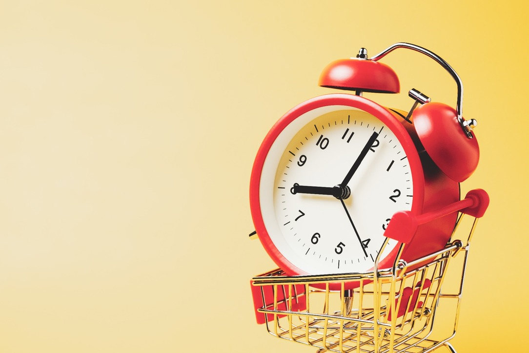 A shopping trolley with an alarm clock in.