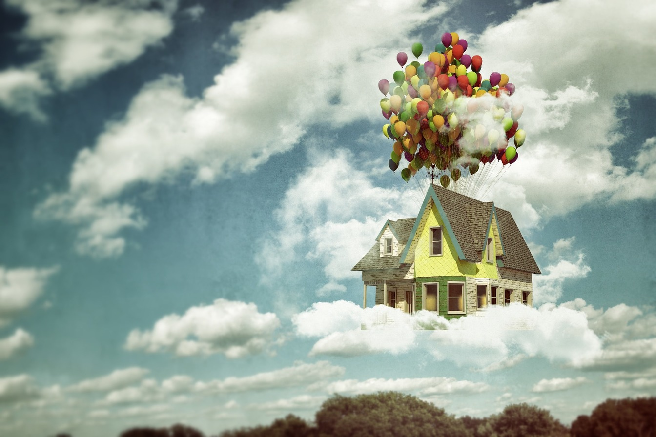 A large house in the clouds being lifted by lots of coloured balloons