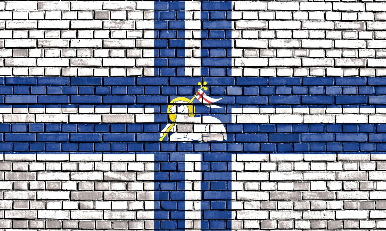 A brick wall painted in the flag of Preston, with a sheep and the proud preston symbol