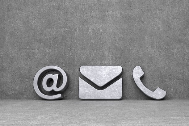 An '@' sign, an email envelope and a telephone symbol.