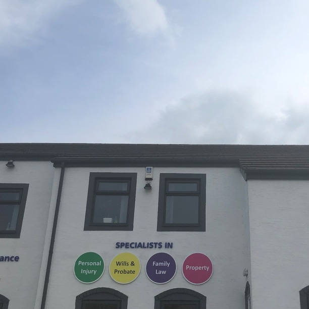 MG Legal's four coloured balls on the exterior of our Garstang office