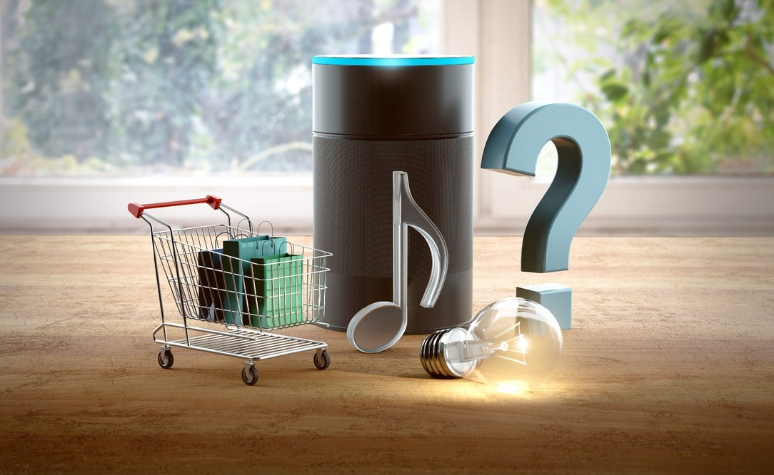 An Alexa with relevant items surrounding it, including a shopping trolley, a question mark, a lightbulb and a musical note.