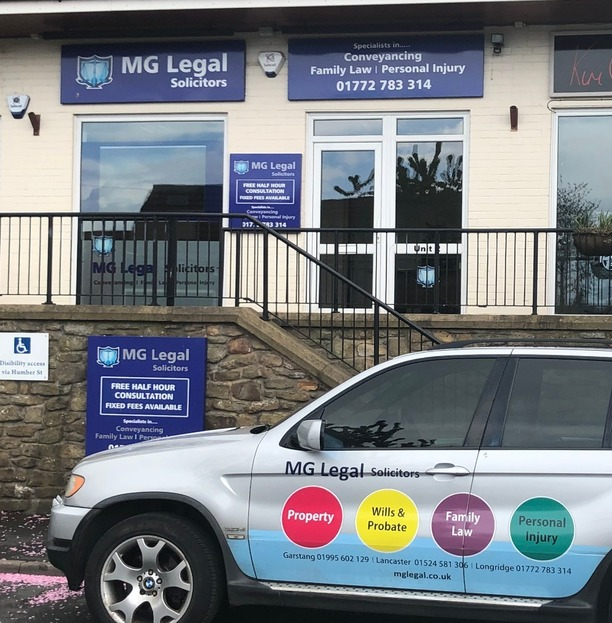 MG Legal's Longridge office showing the stairs outside our offices, with the 'Free Half Hour Consultation and Fixed Fees available sign'.