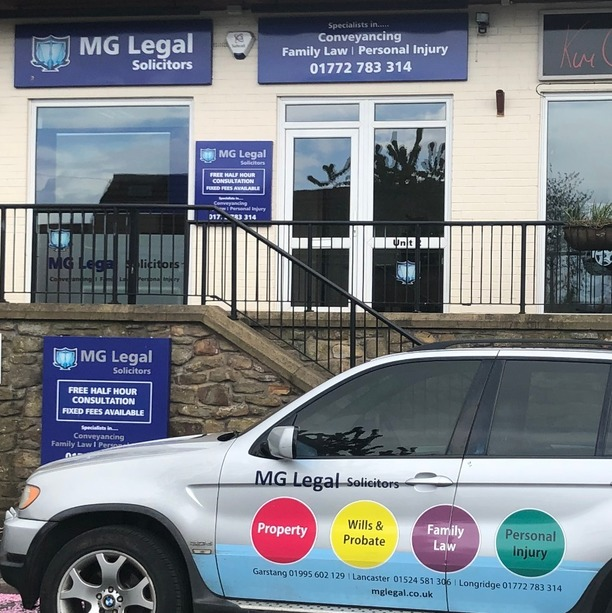 The exterior of our Longridge office, with our blue information sign, and our contact information.