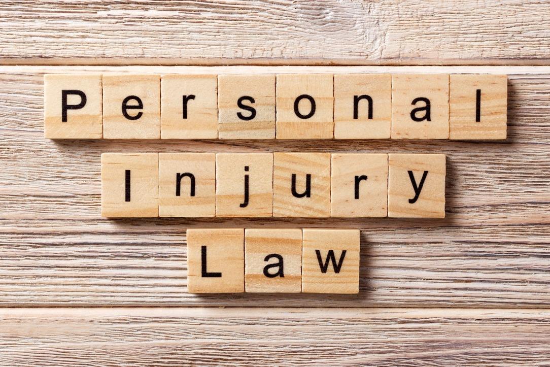'Personal Injury Law' written on wooden blocks.