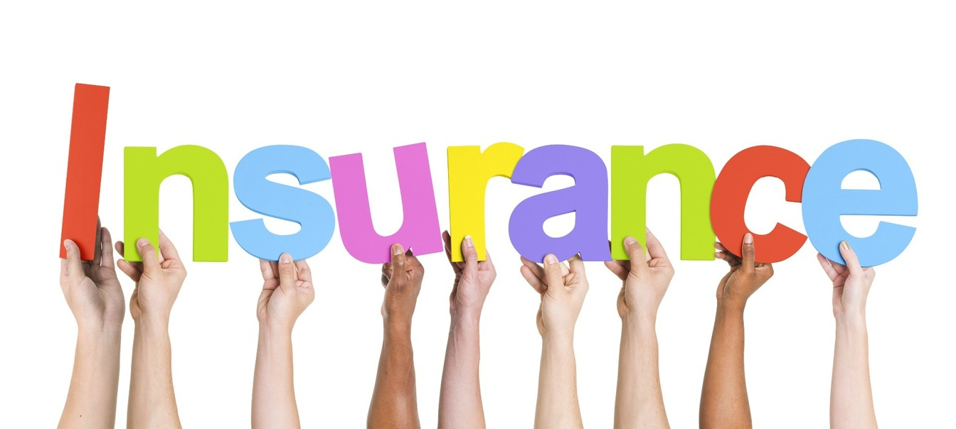 'Insurance' written in bold, cut out letters, held up by people