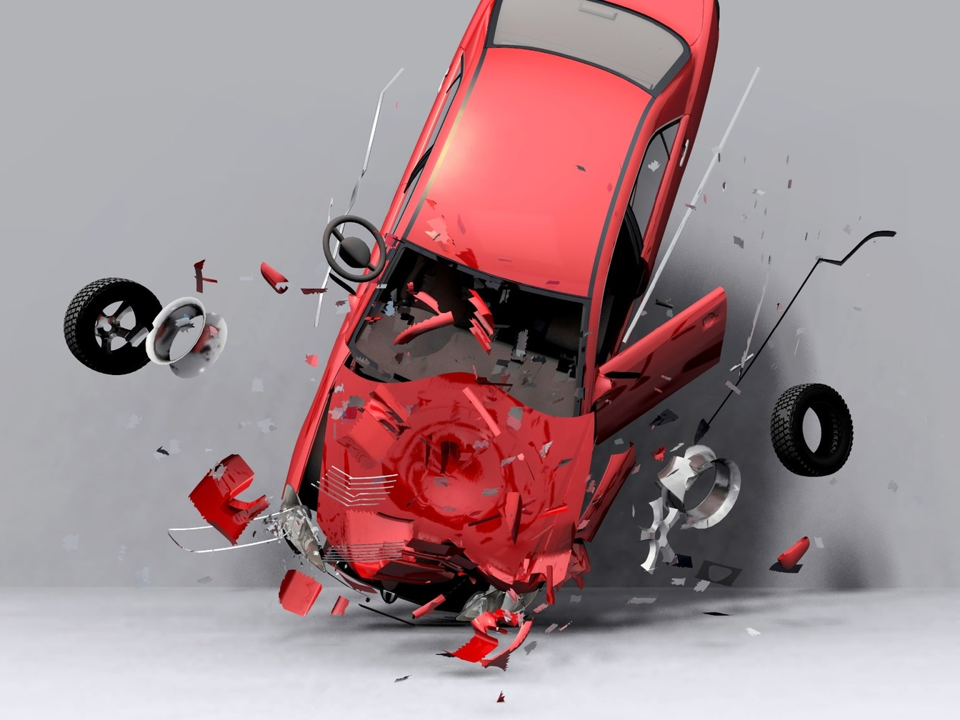 A red car which has been in an accident, smashed from the front, the tires have flown off.