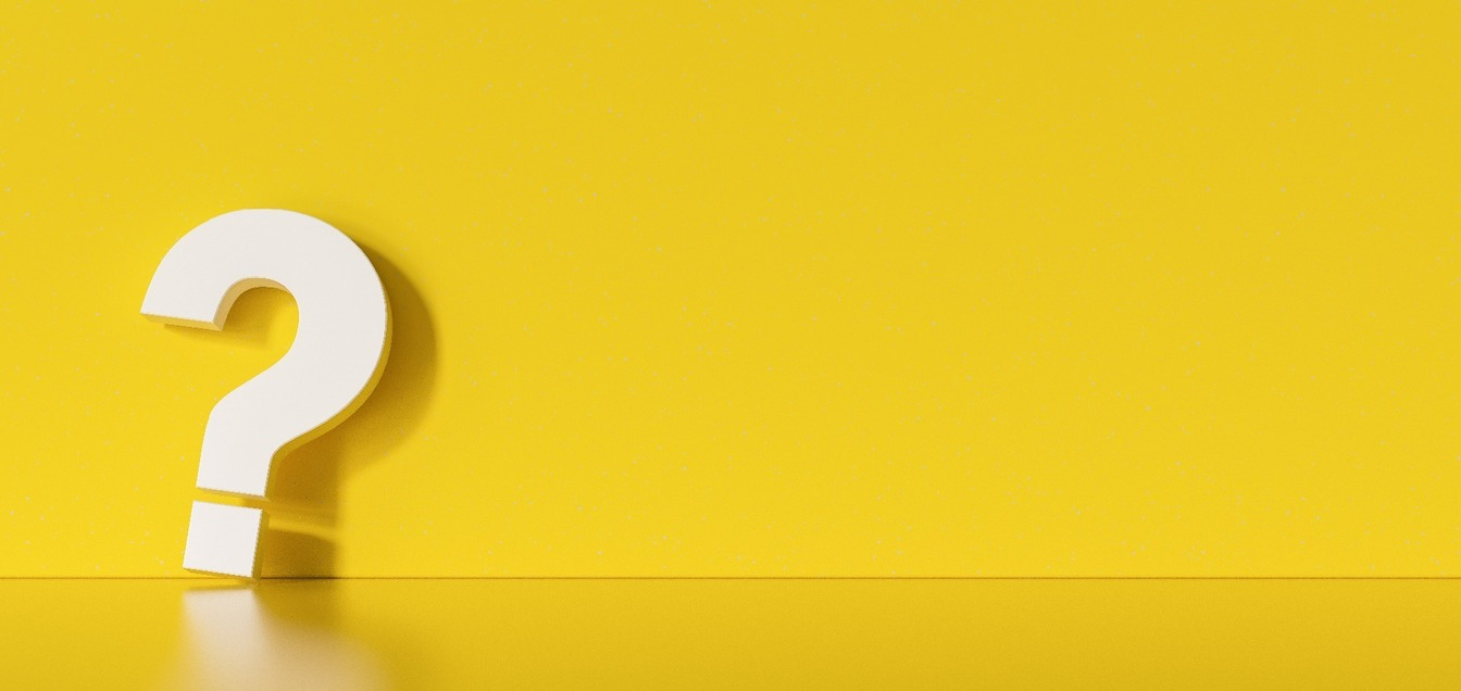 A white question mark on a yellow background