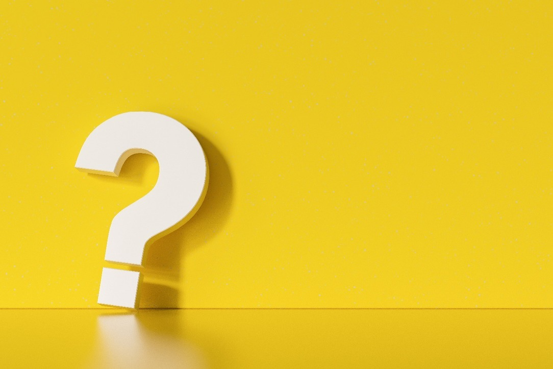 A big white question mark against a yellow background.