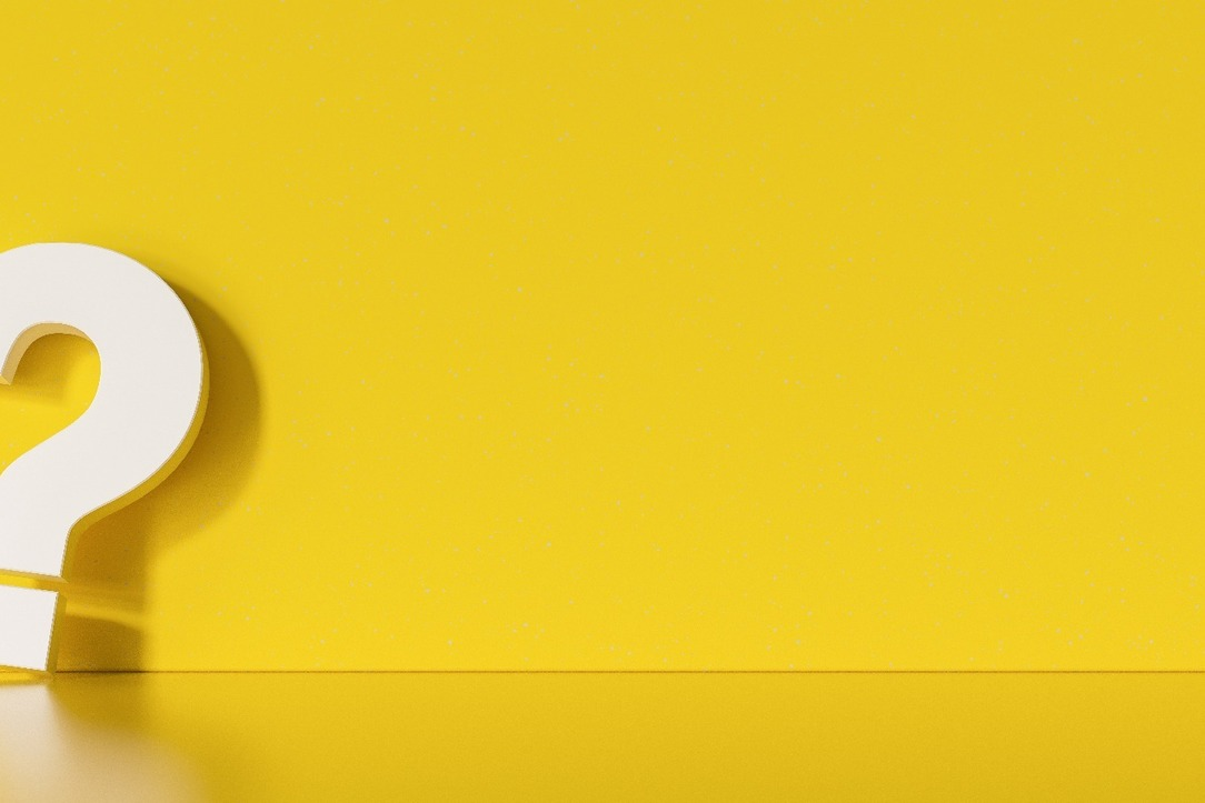 A large, white question mark (3D) against a yellow background.