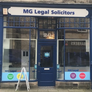 MG Legal's Lancaster office with blue painted exterior, and our A-Board sign on Brock Street.