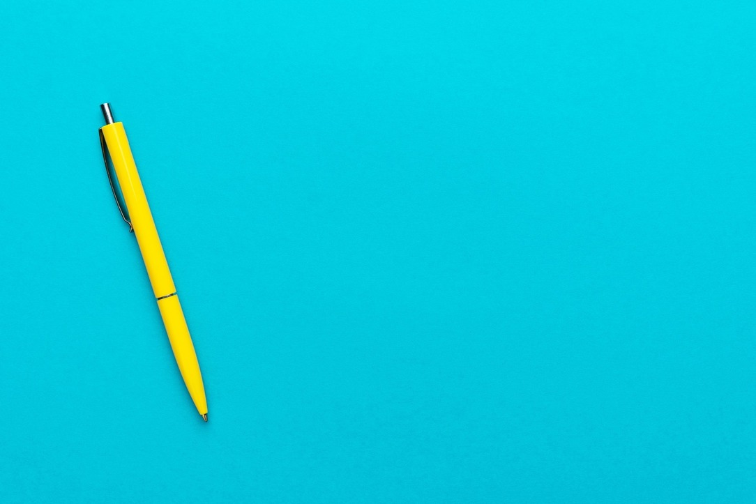 A bright yellow pen against a blue background.