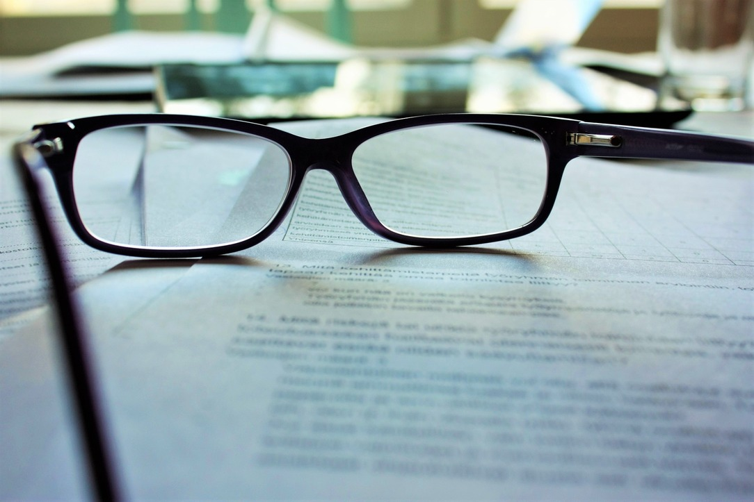 A pair of glasses resting on a legal document.